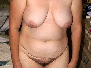 Undressing 50 y.o. Woman