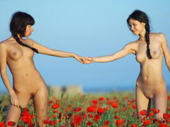 Nudists in Flower Field